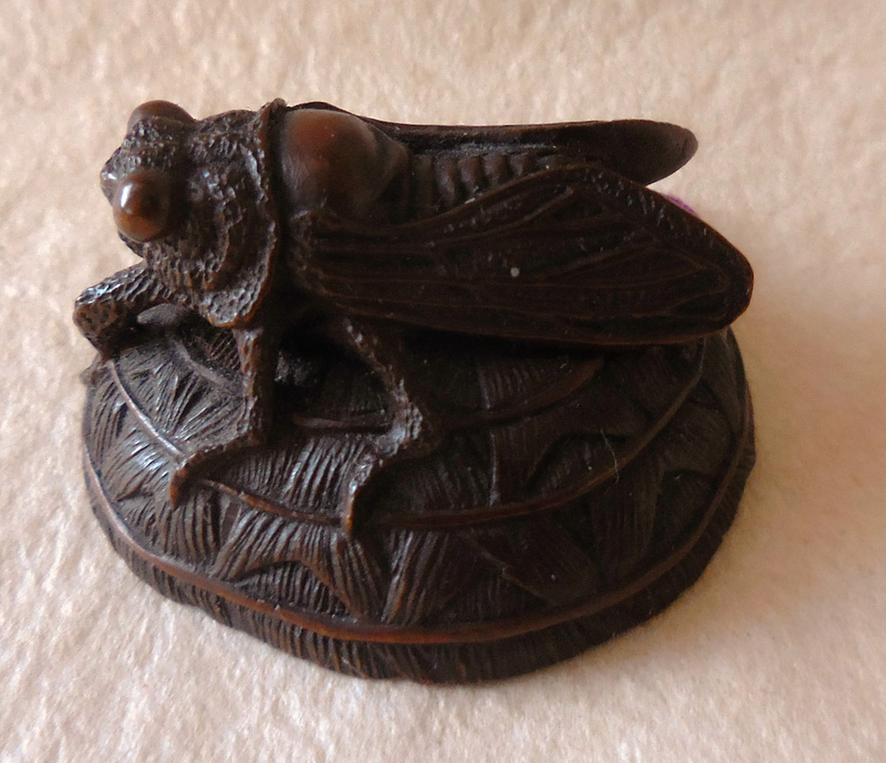 Netsuke of a fly on a hat